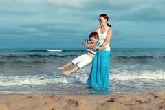 Portrait of happy mother and son at sea Royalty Free Stock Images