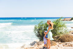 Portrait of happy mother and son at sea, outdoor Royalty Free Stock Photos