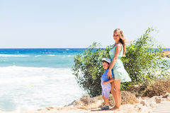Portrait of happy mother and son at sea, outdoor Stock Image