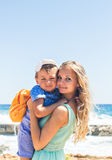 Portrait of happy mother and son at sea, outdoor Stock Images