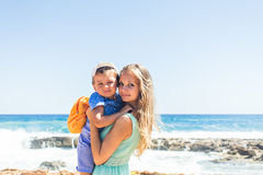 Portrait of happy mother and son at sea, outdoor Royalty Free Stock Photo