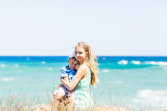 Portrait of happy mother and son at sea, outdoor Royalty Free Stock Photography