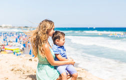 Portrait of happy mother and son at sea, outdoor Stock Photos