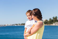 Portrait of happy mother and son at sea, outdoor Royalty Free Stock Image
