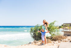 Portrait of happy mother and son at sea, outdoor Stock Photography