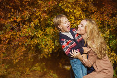 Portrait happy mother and son smile in a park in the autumn. Portrait happy mother and son smile in a park in autumn Royalty Free Stock Photo