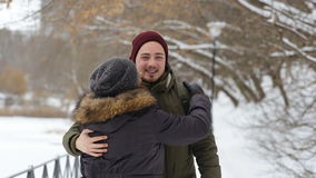 Portrait of a happy mother and son standing on the winter alley and smiles stock video footage