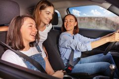 Mum and two teenage daughters on road trip in car royalty free stock photos