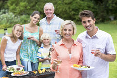 Portrait of happy multi-generation family enjoying barbecue and wine Royalty Free Stock Photography