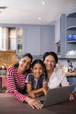 Portrait of happy multi-generation family in kitchen. At home stock photos