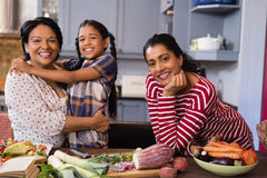 Portrait of happy multi-generation family standing in kitchen Royalty Free Stock Photo
