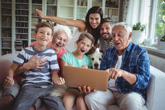 Portrait of happy multi generation using laptop. At home Stock Photos