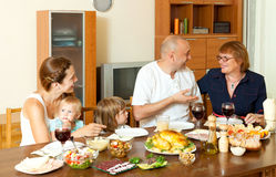 Portrait of happy multigeneration family communicate over holida. Y table at home interior Royalty Free Stock Images