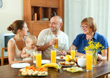Portrait of happy multigeneration family  eating friuts and vege Stock Photo