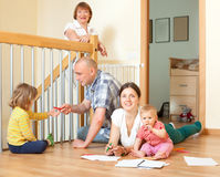 Portrait of happy multigeneration family with little children co. Mmunicate at home in linibf room Royalty Free Stock Photo