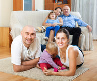 Portrait of happy multigeneration. Family with little children at floor in home Royalty Free Stock Photo