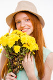 Portrait of happy natural girl in boonie hat holding flowers Royalty Free Stock Photo