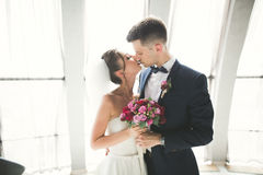 Portrait of happy newly wedding couple with bouquet Royalty Free Stock Images