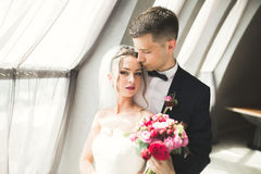 Portrait of happy newly wedding couple with bouquet Royalty Free Stock Photo