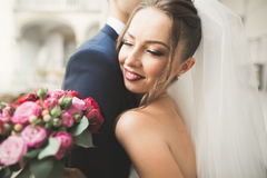 Portrait of happy newly wedding couple with bouquet Royalty Free Stock Image