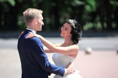 Portrait of a happy newlywed couple in the backdrop of the Park. On a Sunny day royalty free stock photography