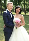 Portrait of happy newlyweds on the background of the Park. Royalty Free Stock Images
