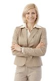 Portrait of happy office worker in beige suit Stock Images