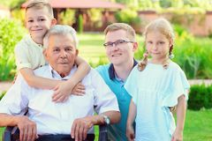Portrait of happy old grandfather and cute children Royalty Free Stock Images