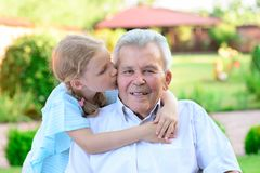 Portrait of happy old grandfather and cute children Stock Photos