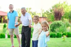 Portrait of happy old grandfather and cute children Royalty Free Stock Photography