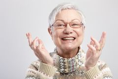 Portrait of happy old woman. Closeup portrait of happy old woman gesturing by hands Royalty Free Stock Images