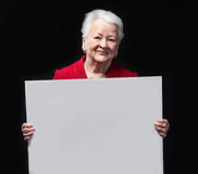 Portrait of happy old woman holding blank billboard Stock Photo