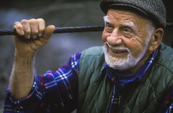 Portrait of a happy, older man. An older gentleman is focused in a pleasent conversation royalty free stock photos