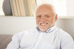 Portrait of happy older man. Closeup portrait of happy older man with white hair, smiling at camera royalty free stock photos