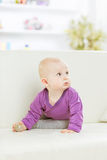 Portrait of a happy one year old baby girl on a background of bright children`s room. Happy one year old baby girl on a background of bright children`s room.the Stock Photos