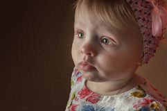 Portrait happy one year old girl posing in playing room royalty free stock images