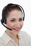 Portrait of a happy operator posing with a headset Stock Photo