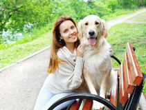 Portrait of happy owner and Golden Retriever dog sitting togethe Royalty Free Stock Image