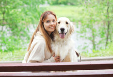 Portrait of happy owner woman and Golden Retriever dog Royalty Free Stock Images