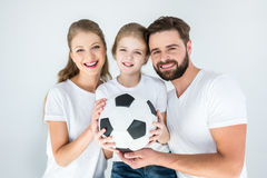 Portrait of happy parents and daughter holding soccer ball Stock Photos
