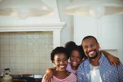 Portrait of happy parents and daughter in kitchen Royalty Free Stock Image