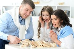 Portrait of happy parents and daughter playing royalty free stock photo