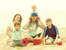 Portrait of happy parents and their children on  sand Royalty Free Stock Images