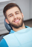 Portrait of happy patient in dental chair. Royalty Free Stock Images
