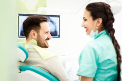 Portrait of happy patient in dental chair Stock Photography