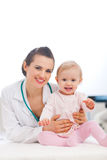 Portrait of happy pediatric doctor and baby Royalty Free Stock Image
