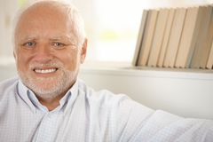 Portrait of happy pensioner. Closeup portrait of happy pensioner smiling at camera royalty free stock photos