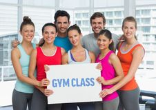 Portrait of happy people holding placard with text gym class Royalty Free Stock Photos