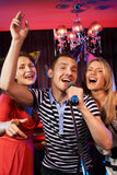Singing friends Stock Image
