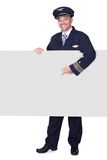 Portrait Of Happy Pilot Holding Blank Placard Royalty Free Stock Photo